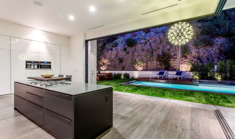 This kitchen opens up completely to the backyard, perfect for entertaining.