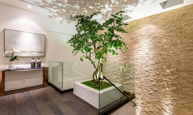 At the top of these stairs is a dedicated space for the custom bonsai tree, designed to definitely make a statement.