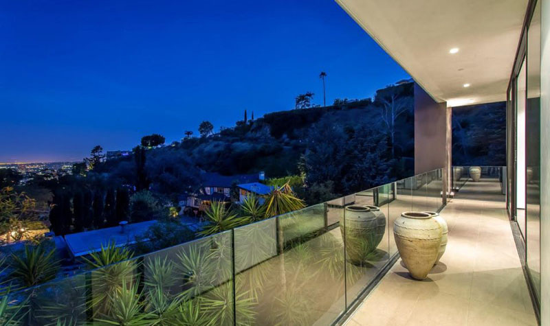 This balcony has glass safety railings to provide a seamless look.