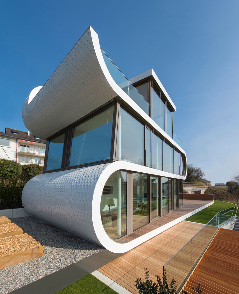 A white ribbon winds its way through this house in for Amazing house design architecture