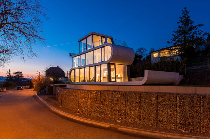 At night, this home in Switzerland lights up like a lantern.