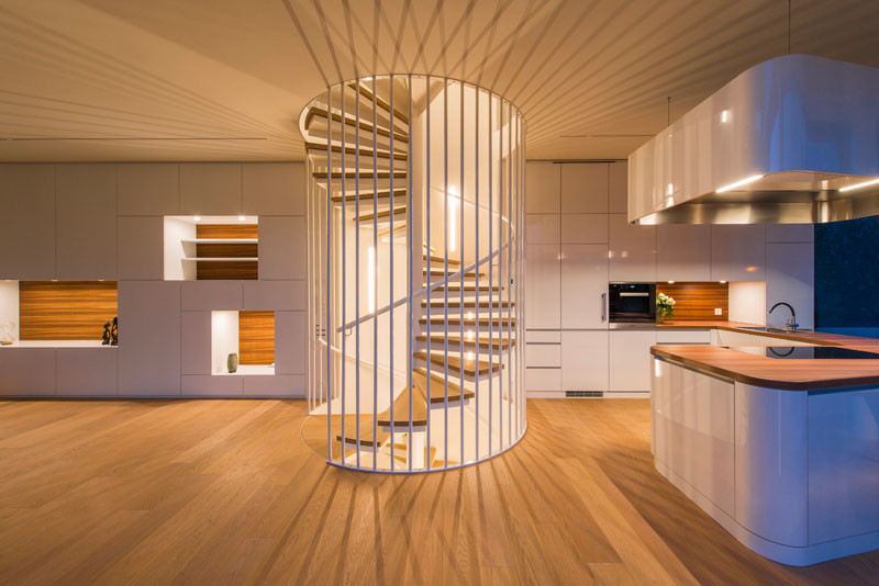 This lit up spiral staircase is like a piece of art in this home.