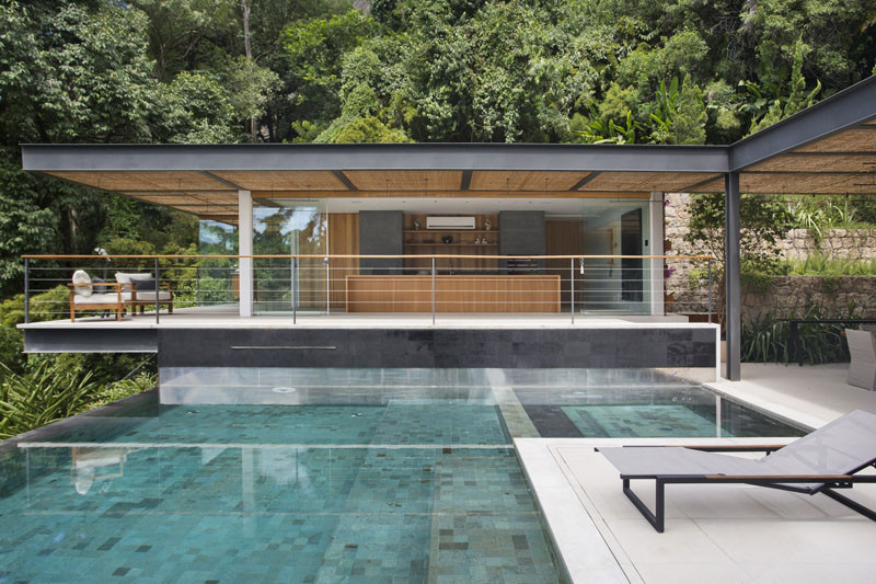 this pool house has picturesque views of the mountainous. Black Bedroom Furniture Sets. Home Design Ideas