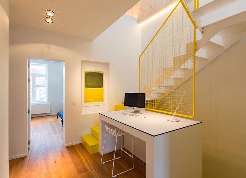 These Bright Yellow Stairs Include Hidden Spaces For Storage