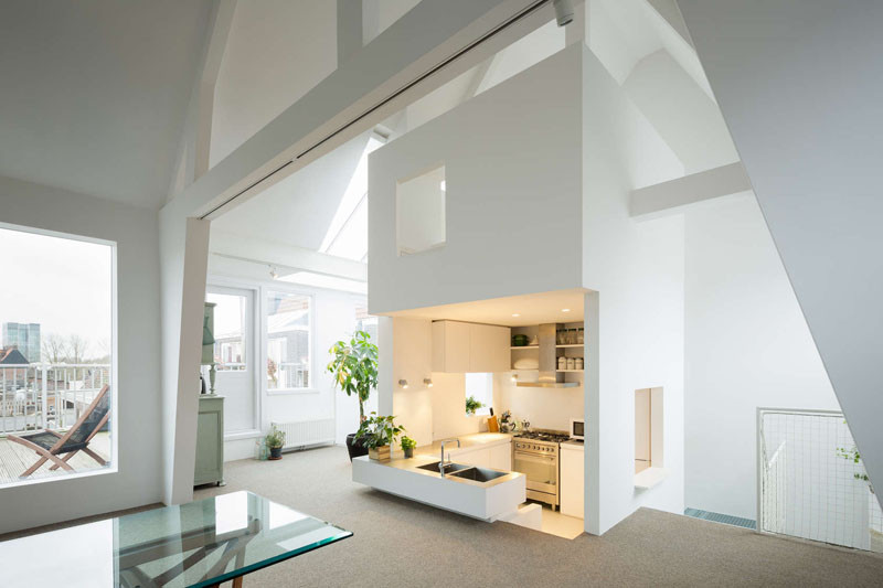 This apartment in Amsterdam has a sunken kitchen