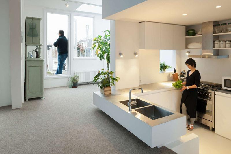 This apartment in Amsterdam has a sunken kitchen