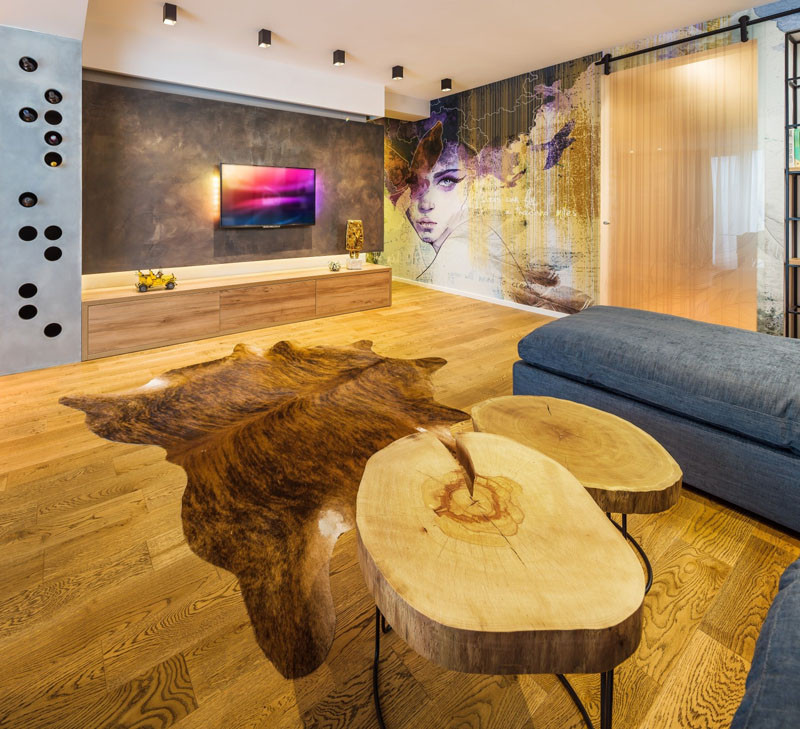 A Large Wall Mural Dominates This Young Couple's Apartment