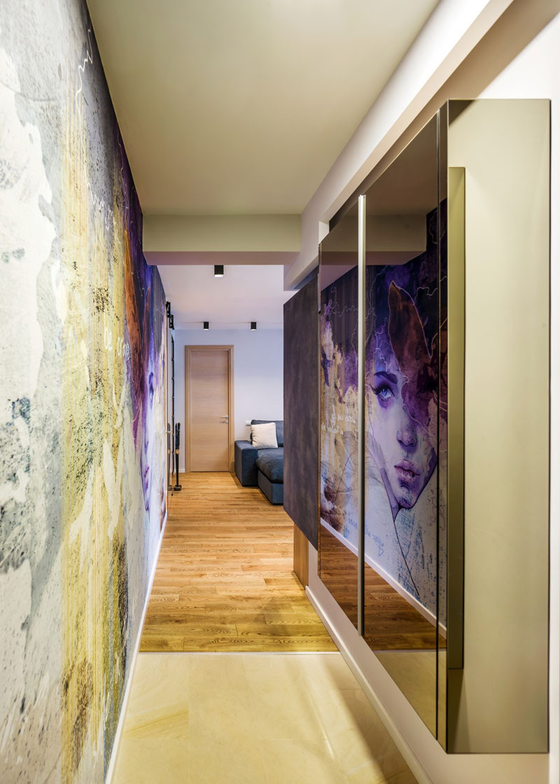A Large Wall Mural Dominates This Apartment