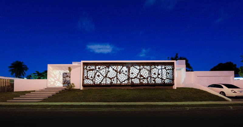 A Decorative Steel Screen Covers The Front Windows Of This Home