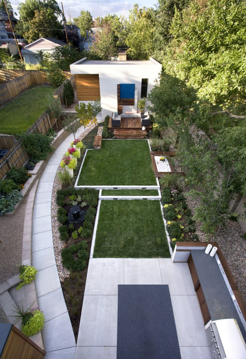 16 Inspirational Backyard Landscape Designs As Seen From Above // This backyard has a number of defined areas, like a seating area, sandbox, and outdoor kitchen, that allow for entertaining, chatting, playing, and gardening.