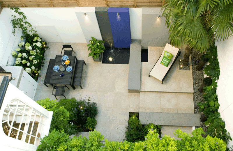 16 Inspirational Backyard Landscape Designs As Seen From Above // More patio-like than backyard-like, this space with a water feature, still offers a relaxing place to gather or enjoy the sun solo.