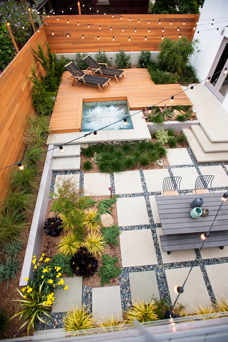 16 Inspirational Backyard Landscape Designs As Seen From Above // This backyard is made up of two separate areas surrounding a hot tub, making it a great spot to gather with friends and family. #Backyard #YardIdeas #LandscapingIdeas #YardLayout #YardDesign