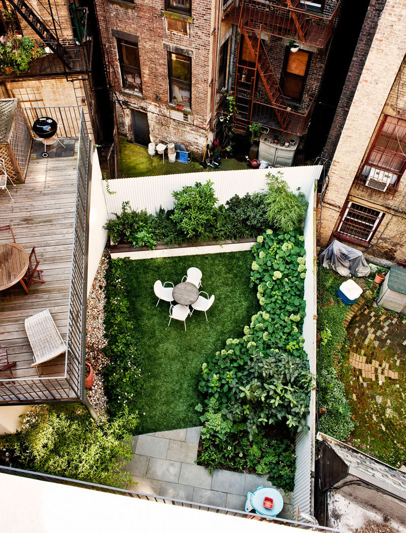 16 Inspirational Backyard Landscape Designs As Seen From Above // This backyard maximizes space with the patio above and the green space below.