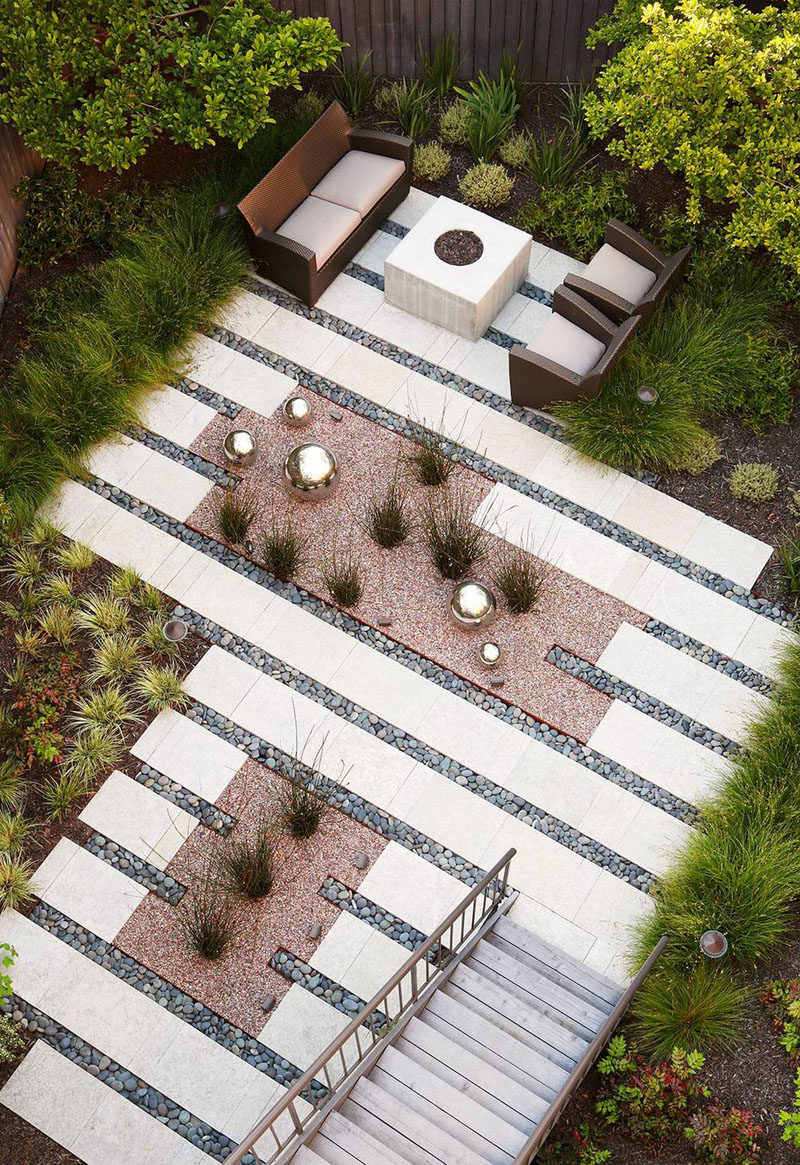 16 Inspirational Backyard Landscape Designs As Seen From Above // This backyard oasis might lack traditional grass but the planted grasses, ferns, and trees still make it feel like a proper backyard.