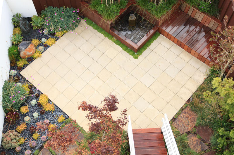 16 Inspirational Backyard Landscape Designs As Seen From Above // This angular backyard patio is surrounded by a succulent garden, a water feature, and seating area. #Backyard #YardIdeas #LandscapingIdeas #YardLayout #YardDesign