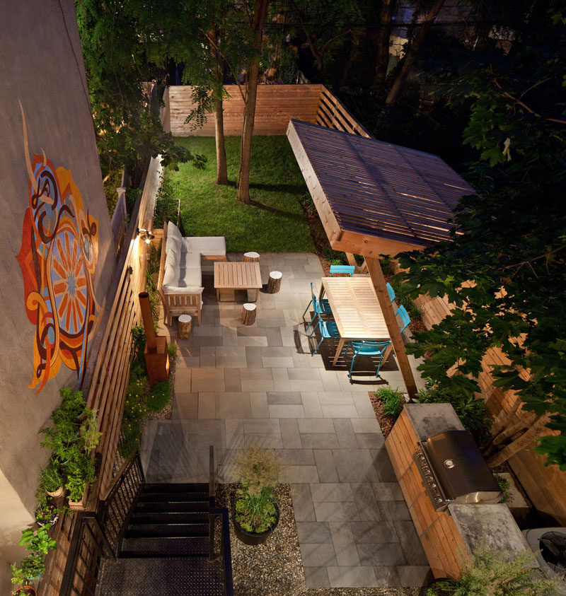 16 Inspirational Backyard Landscape Designs As Seen From Above // This backyard has an outdoor kitchen and covered dining area, as well as a lounge and fireplace. #Backyard #YardIdeas #LandscapingIdeas #YardLayout #YardDesign