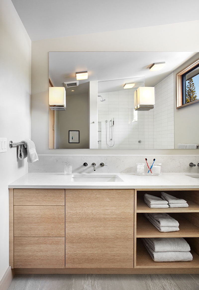 The Combination Of Drawers A Cabinet And Open Shelving Make For Variety Bathroom Storage Options In This Wooden Vanity