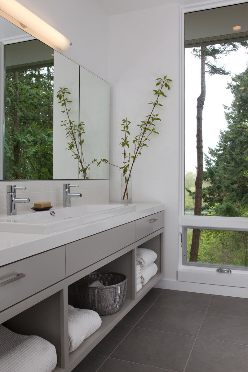 15 Examples of Bathroom Vanities That Have Open Shelving // The large open shelves in this vanity are large enough to house baskets of toiletries as well as multiple fluffy towels.
