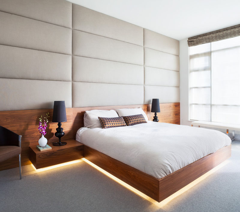 9 Bedrooms With Beds That Feature Hidden Lighting // This already bright bedroom added a strip of LED lights to the bottom of this bed for a warmer light.