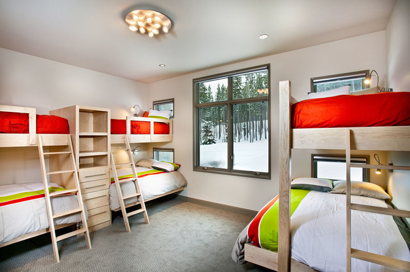 Interior Design Ideas For Sleeping Six People In A Room // This ski home designed by New Mood Design, has a bedroom with 6 built-in beds, perfect for sleepovers on the slopes.