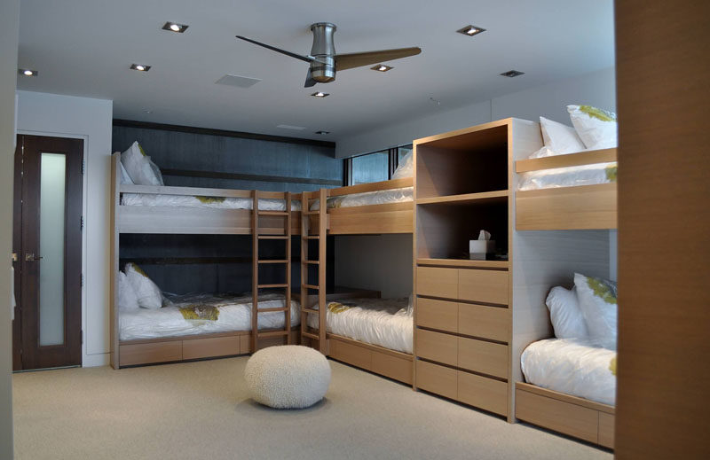 Interior Design Ideas For Sleeping Six People In A Room // These six bunks were designed and custom built by Accent Custom Furniture, to fit the room perfectly.