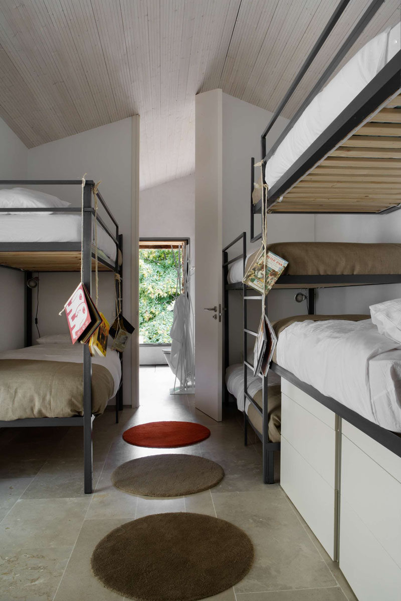 Interior Design Ideas For Sleeping Six People In A Room // These standalone bunk beds can be found in an old converted Spanish stable designed by Abaton Architects.