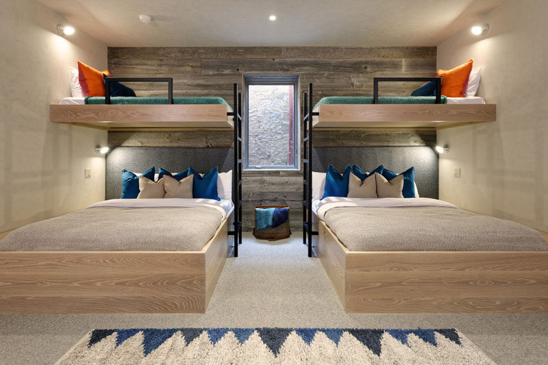 Cute These bunk beds are positioned around a window so not to block the natural light from entering the space The room designed by Kaegebein Fine Home