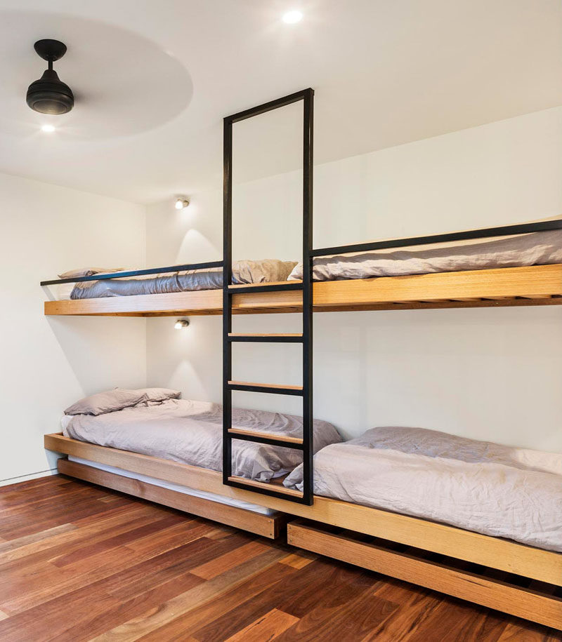 Interior Design Ideas For Sleeping Six People In A Room // These bunk beds designed by ARKit, both have trundle beds that roll out for sleeping extra people.