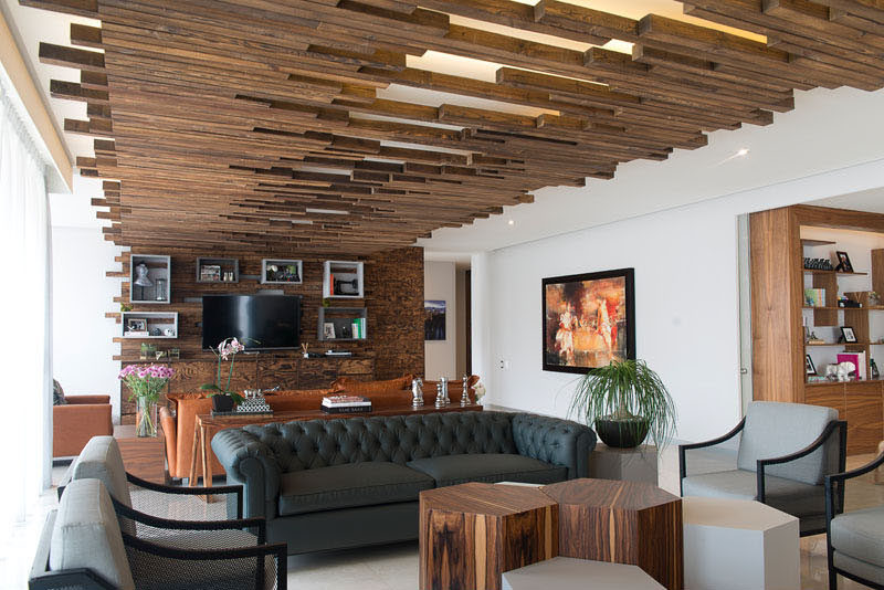 the decorative ceiling design in this living room will get