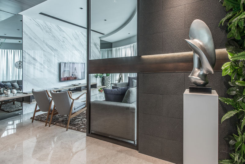 A sculptural element on a pedestal greets you as you enter this apartment.