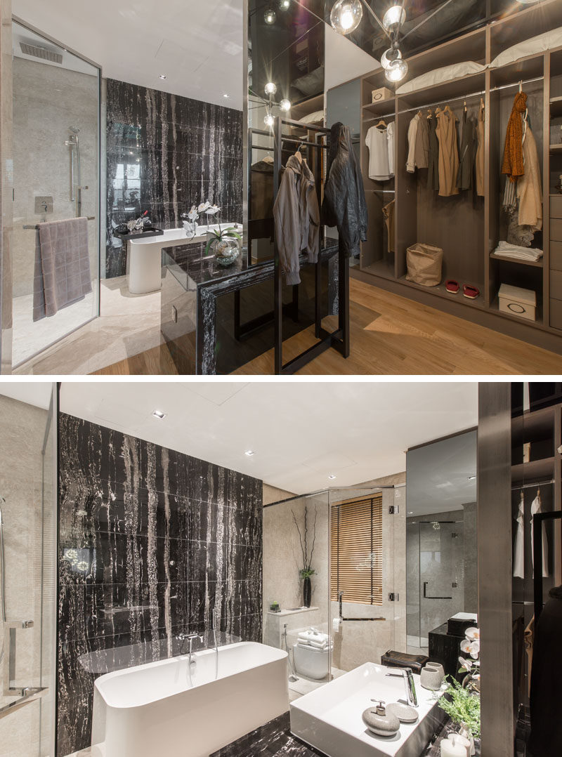 Tucked away behind this walk-in closet is the bathroom, complete with a stone feature wall behind the bath, and a glass enclosed shower tucked into the corner.