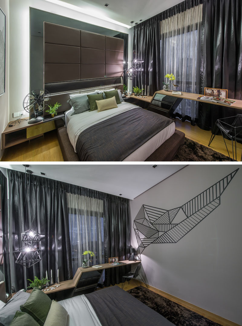 In this bedroom there is a custom designed desk against the window, and graphic art on the wall.