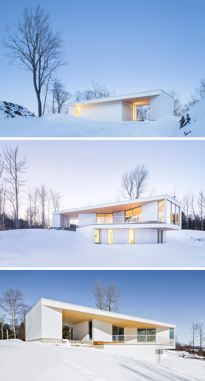 This home, located in the quiet area of Mansonville, Québec, sits peacefully, appearing to almost blend in to its surroundings in the winter.