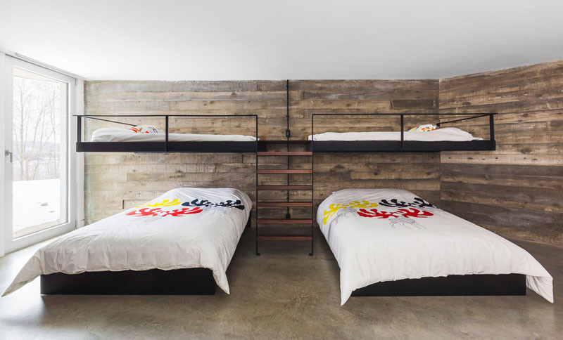 This bedroom is large enough to have two sets of bunk beds, with the upper beds appearing to float above the lower beds.