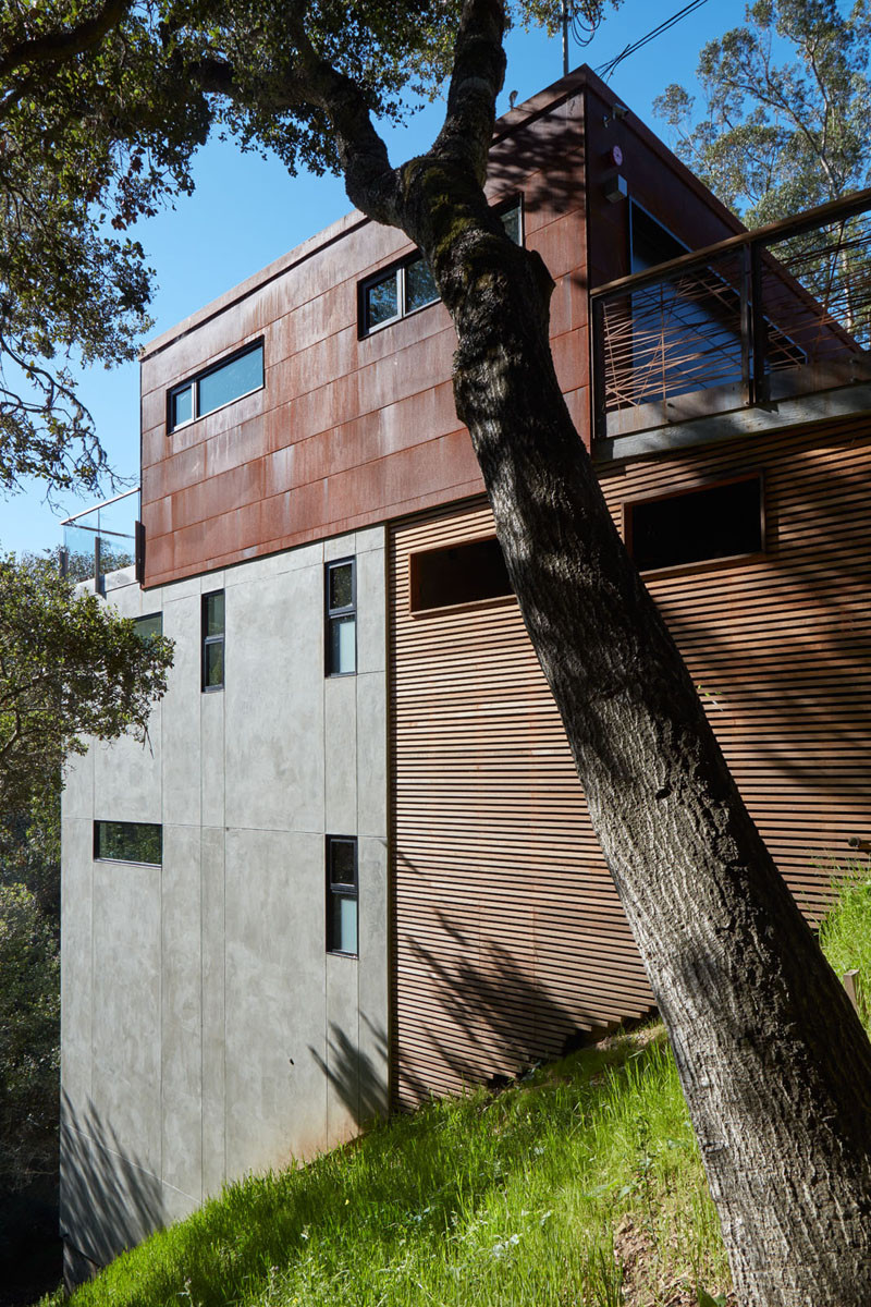 This Home Is Surrounded By Trees And Clad In Corten Steel, Concrete and Wood