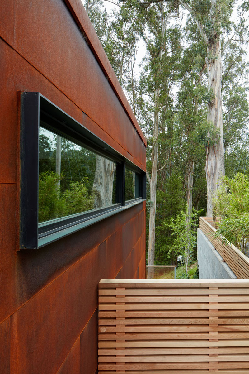 Black window frames contrast the weathering steel siding.