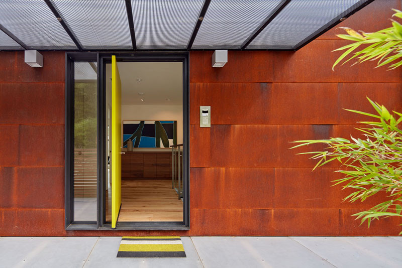 A pivoting bright yellow front door welcomes you to this home.