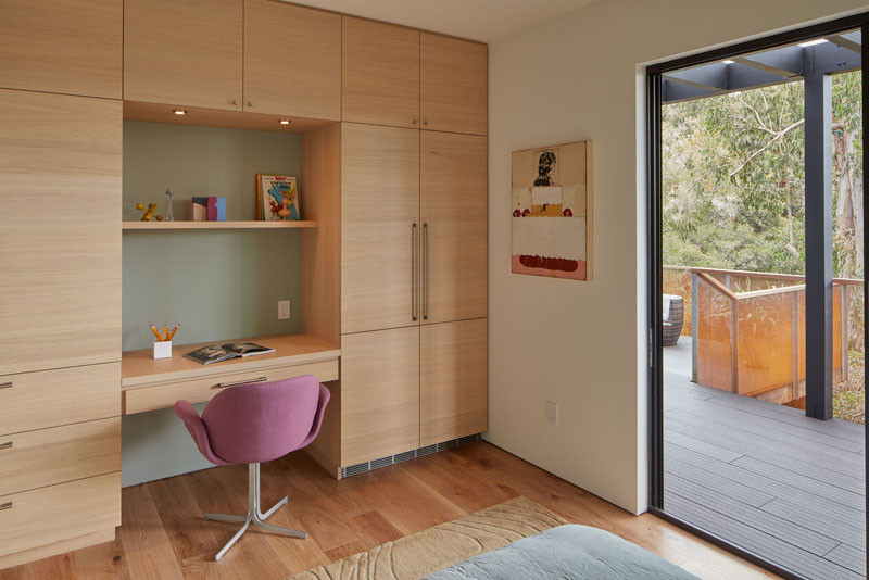 This bedroom has a custom built-in desk and plenty of storage.