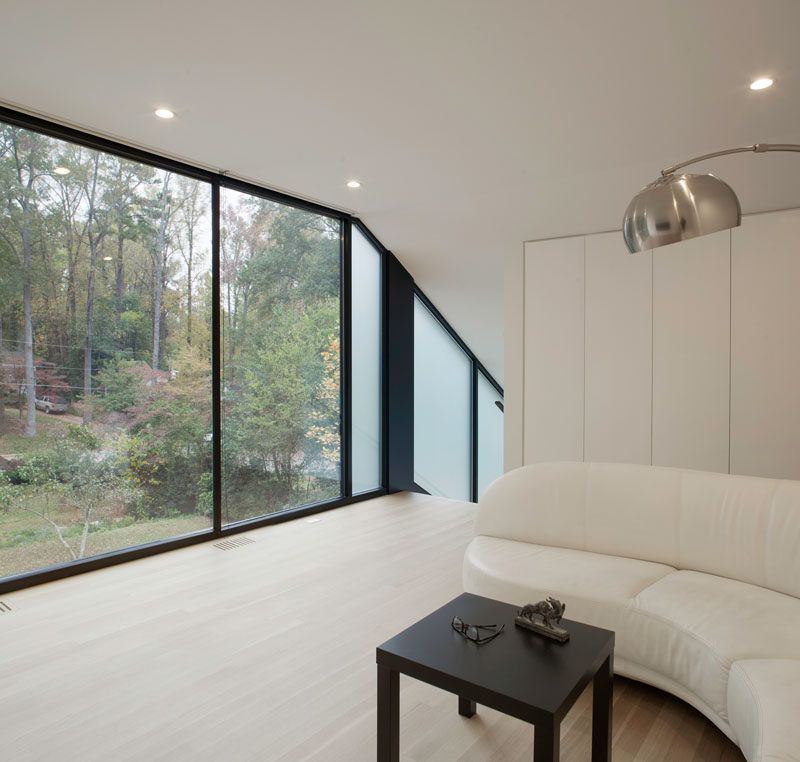 Large floor-to-ceiling windows provide plenty of natural light to the space and views of the surrounding trees