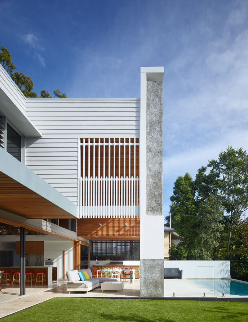 The contemporary Australian home blurs the lines of indoor and outdoor living, with the main floor opening up to the backyard, with a grassed area and swimming pool.