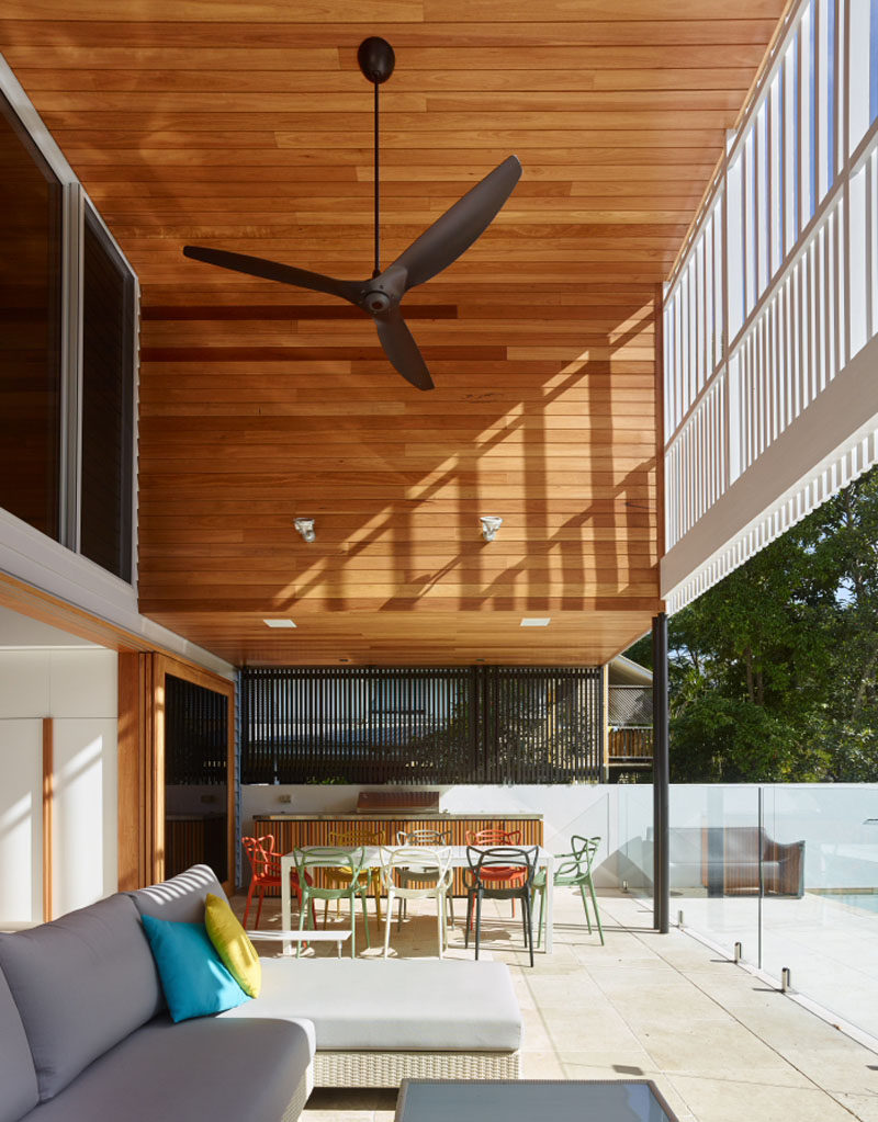 This home, with a double height wooden ceiling, has an outdoor kitchen, dining and lounge area.