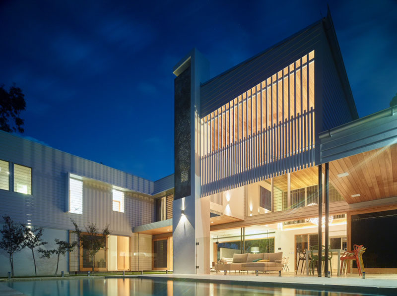 This home in Australia, features a double height ceiling.