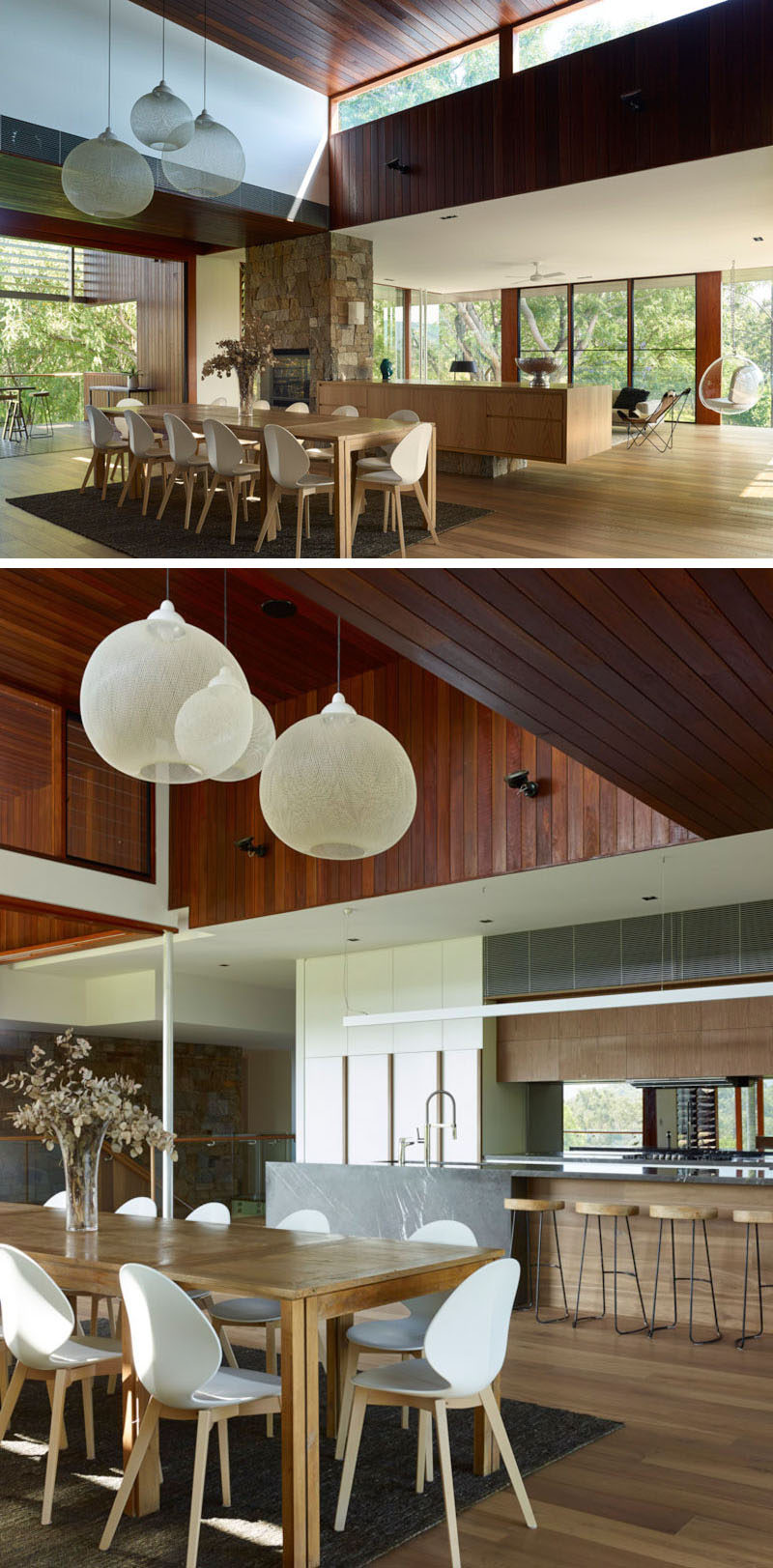 Three white pendant lights and a rug help to anchor the large 12-seater dining table in the open floor plan of this home.