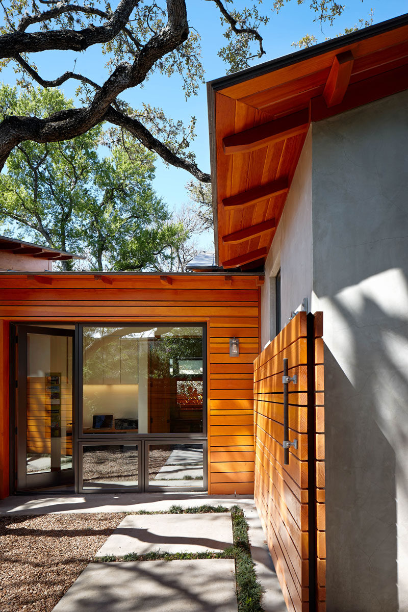 This home has a rolling wooden gate that matches the siding on the house.