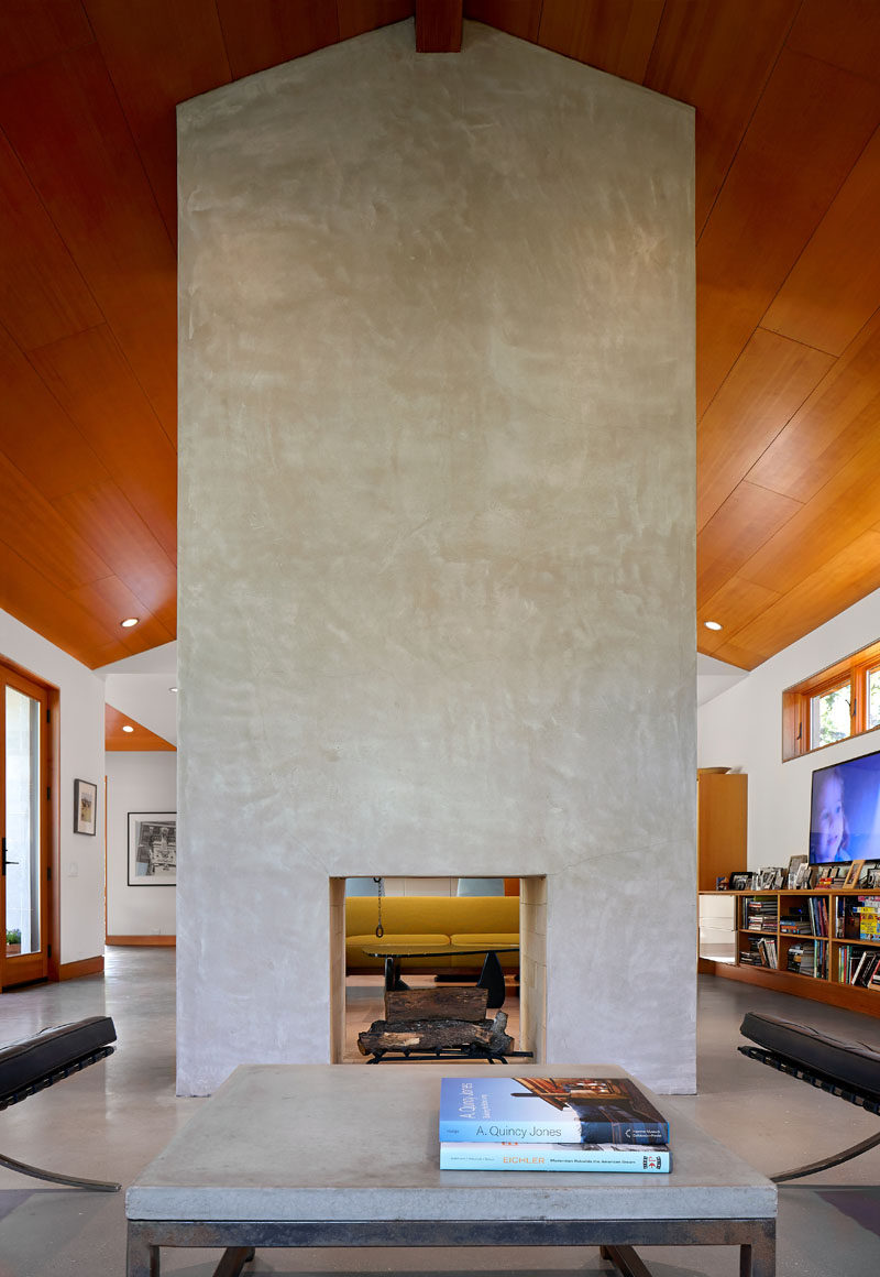Upon entering this home, you are greeted by a large centrally located fireplace that separates the entry lounge area from another sitting area.