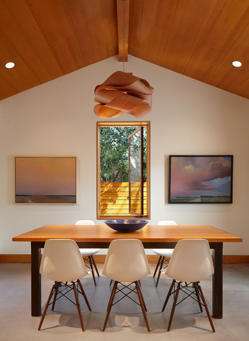 The pendant lamp in this dining room is perfectly positioned in the center of the room and above the window to draw your eye upwards to the ceiling.