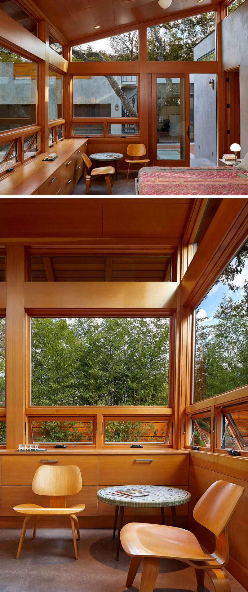 This master bedroom has windows that follow the line of the roof, and built-in wooden cabinetry for storage.