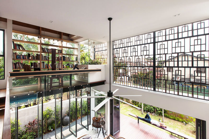 This home has a mezzanine level, home to a library and work area.
