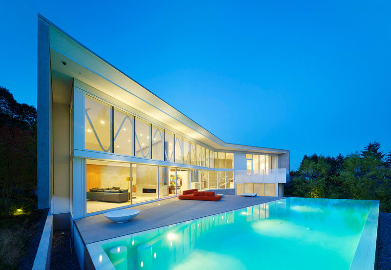 This home in Vancouver, Canada, has a large swimming pool and deck, perfect for entertaining.