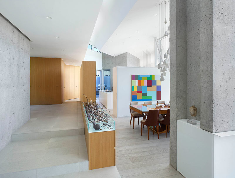 Upon entering this home, designed by BattersbyHowat Architects, the main floor has been split up into different areas, the living room, dining room and kitchen.